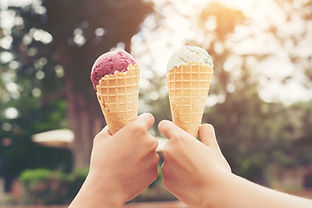 Woman's hands holding melting ice cream
