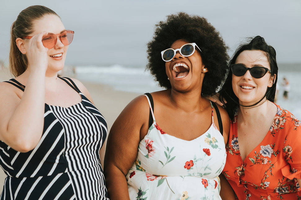 Cheerful diverse plus size women at the