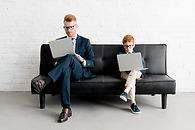father and son reading with eyeglasses on