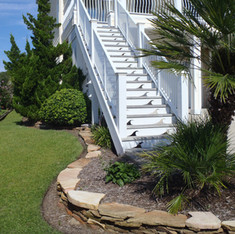 OBX palms and green lawns.