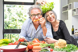 Senior couple having fun in kitchen with