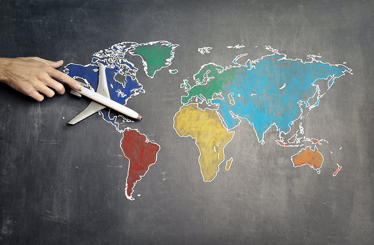 person-with-toy-airplane-on-world-map-37