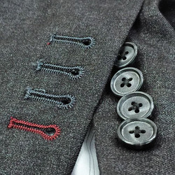 Clean, neat and tight functional buttonholes are crucial to a good suit