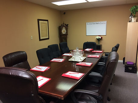 Swindled escape room with boardroom table.
