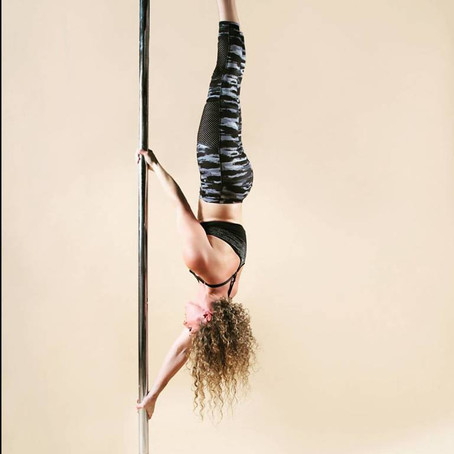 Pole dance and fitness is an amazing workout.