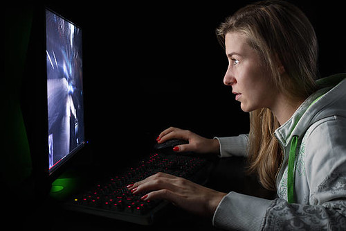 Girl playing on her computer