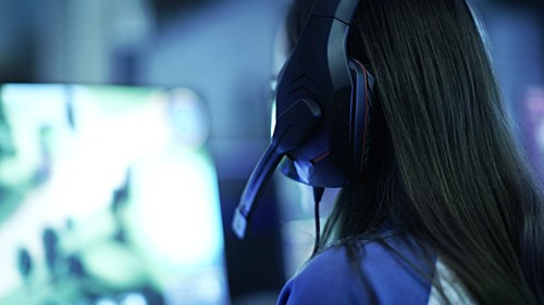 Girl gaming on PC