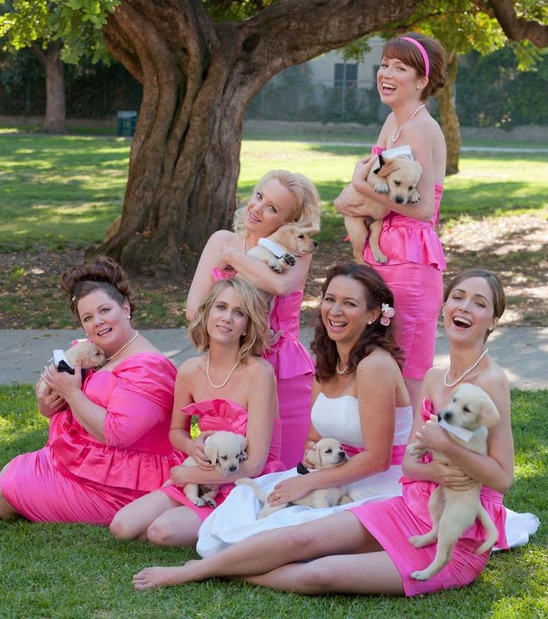 Bridesmaids movie cast holding puppies