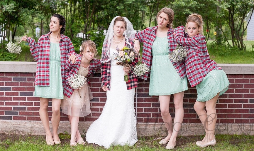 Women in flannel bridesmaids pose