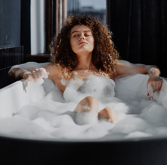 woman-in-bathtub-with-water-4155482_edit