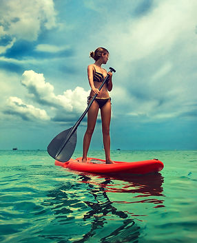 Young slim girl stand up on paddle Board