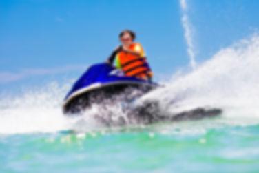Teenager on jet ski. Teen age boy skiing