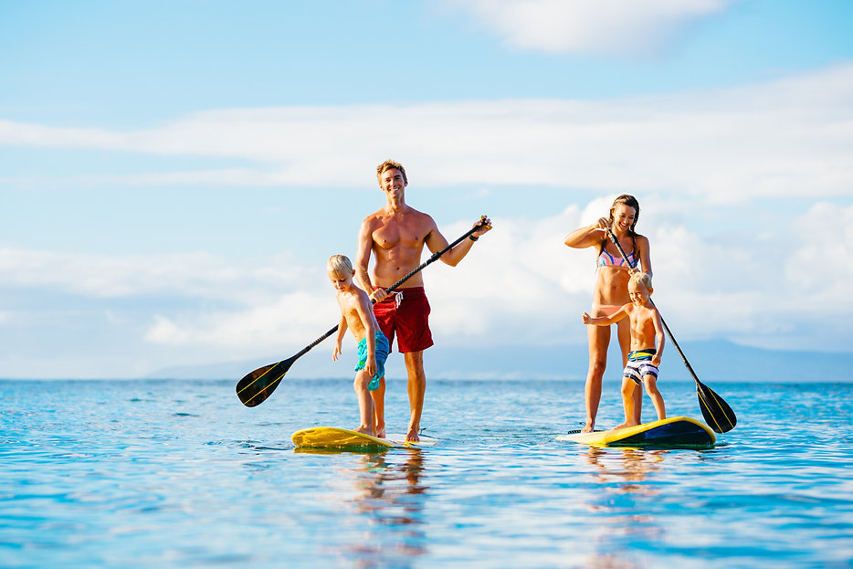 Family Having Fun Stand Up Paddling Toge