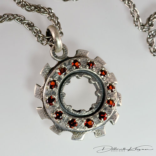 Sterling Silver Gear Shaped Pendant with Twelve Garnets on Sterling Silver Chain Angle View