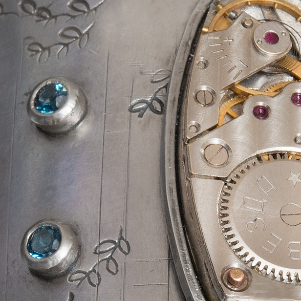 close up of sterling silver bracelet with watch parts by Deborah Klezmer Designs