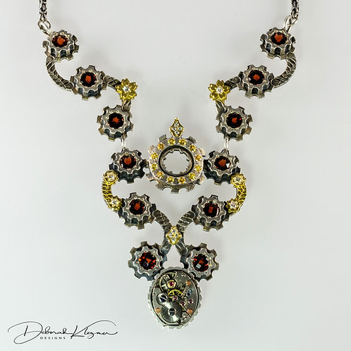 Neckpiece with 18 Karat Yellow Gold, Sterling Silver, White Diamonds, Yellow Sapphires, Garnets and Authentic Watch part