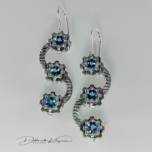 Long Dangle Sterling Silver Earrings with Blue Topaz Set in Klezmer Gear Flowers Front View