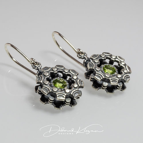 Sterling Silver Dangle Earrings Shaped Like Gear Flowers with Peridot Angle View