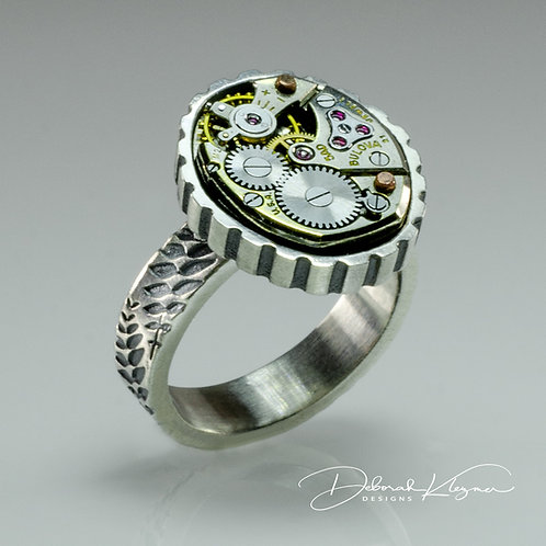 sterling silver ring with antique watch movement and fern motif