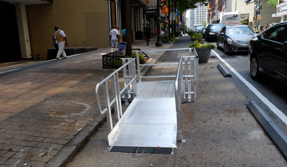ADA ramps installed by the new mid-block crossing