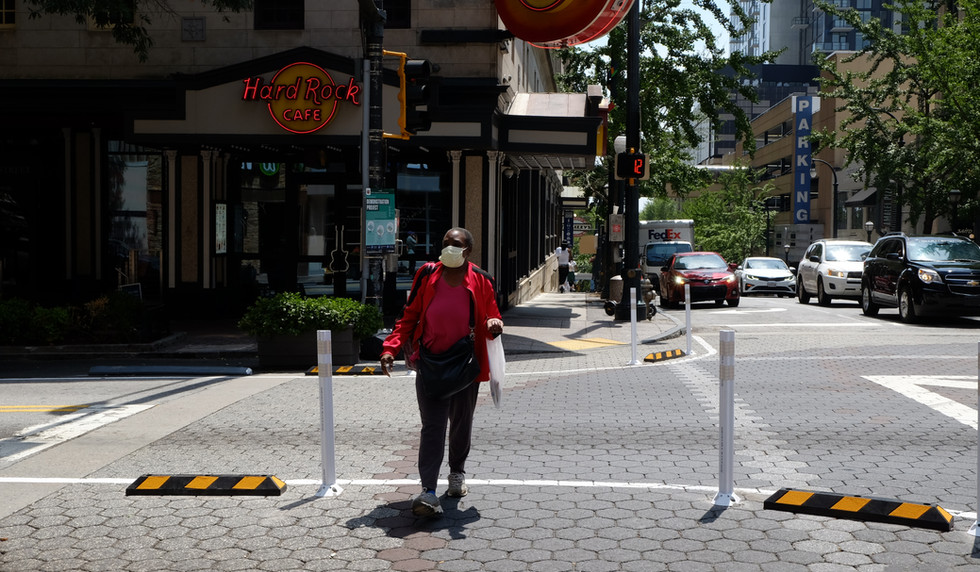Pedestrian crossing the street at Andrew Young International Boulevard