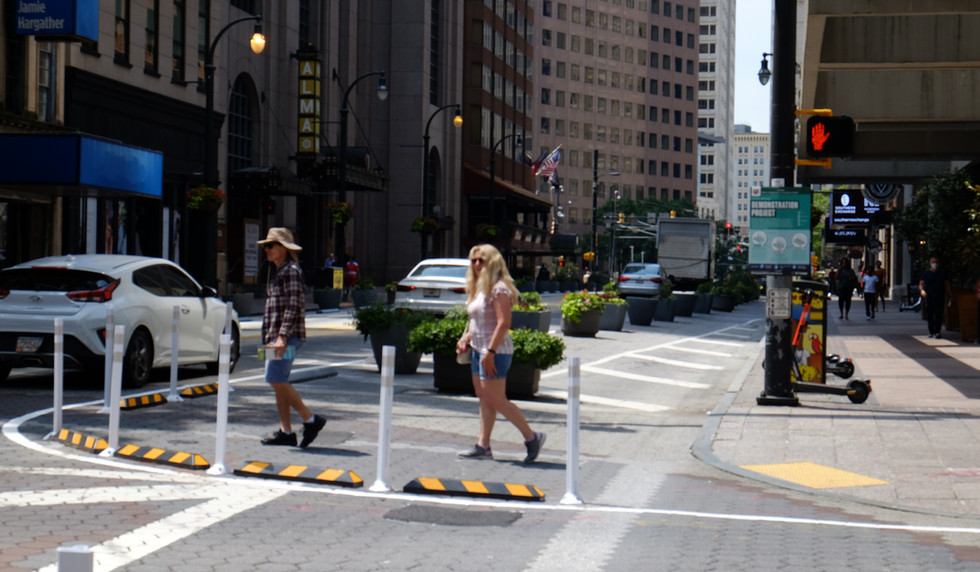 Pedestrians crossing Peachtree Street at the new curb extensions