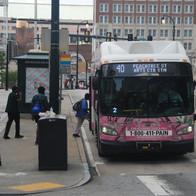 Passengers boarding the Route 40 MARTA bus on Peachtree Street at Marietta Street heading north toward the Arts Center MARTA Station in Midtown.
