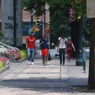 Pedestrians passing by White Oak Kitchen on Peachtree Street.