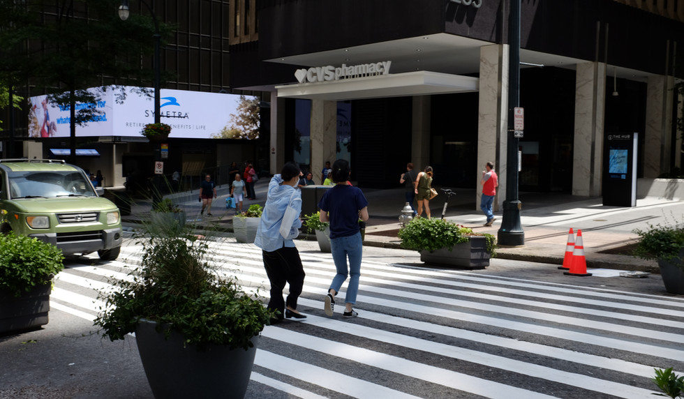 Pedestrians using the new mid-block crossing at Peachtree Center