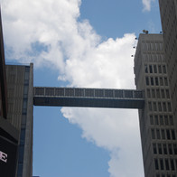 This sky bridge, like several others, connects buildings on either side of Peachtree Street. As a result, people can move throughout this area without walking between buildings on the street.