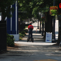 One of Atlanta Downtown Improvement District's Downtown Ambassadors riding a segway along Peachtree Street.