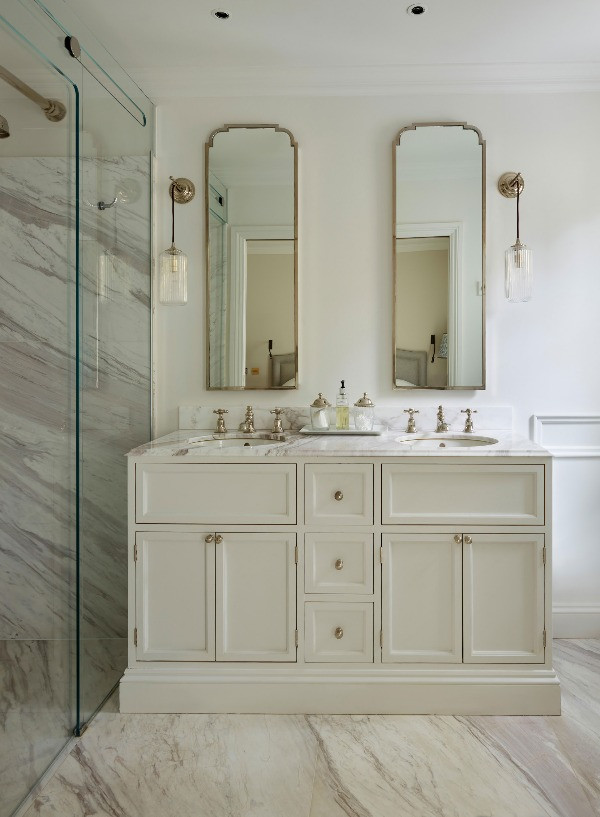 Luxury interiors: The paneled door vanity cabinet has two Moy underhung basins with Mull brassware.