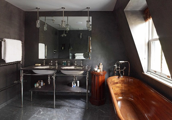 luxury interiors: charcoal grey walls and floor are contrasted with mirror finish nickel brassware and white ceramics
