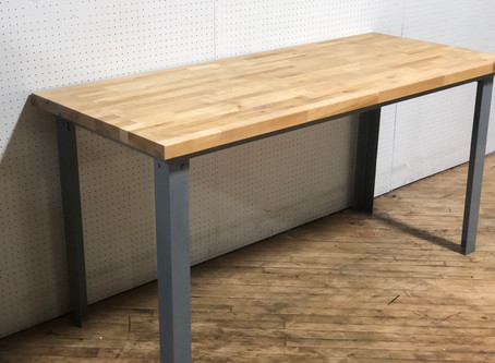 Butcher block table top on an industrial style steel frame.  Counter height.