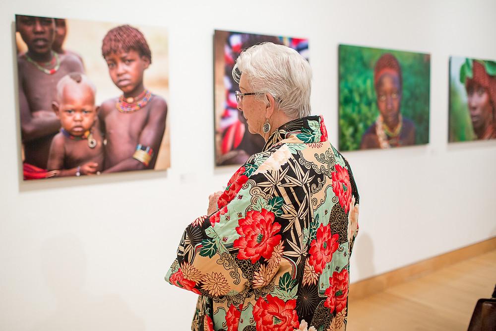 Woman viewing photos at exhibit
