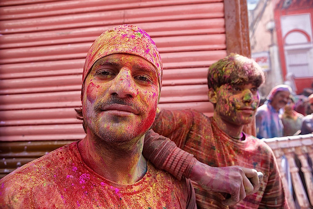 Two young men covered in dye