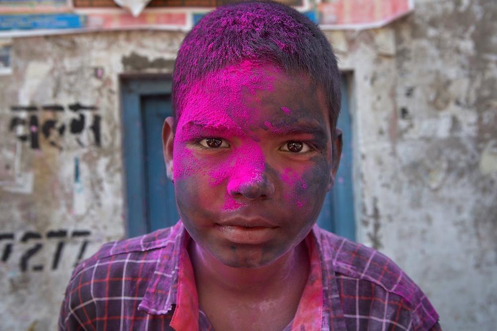 Boy covered in dye