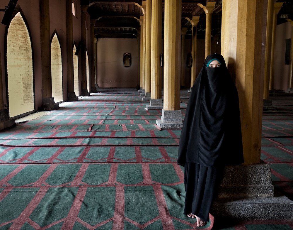 Woman in burka in mosque