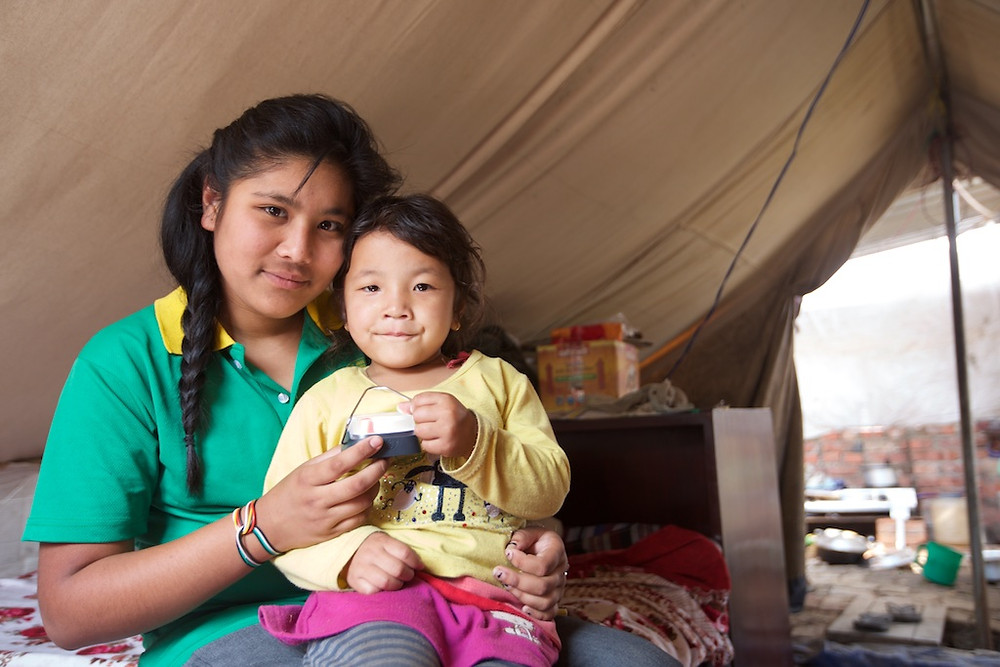Young woman with child in tent