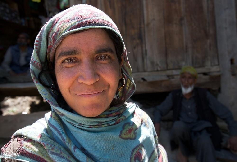 Enigmatic smile under headscarf