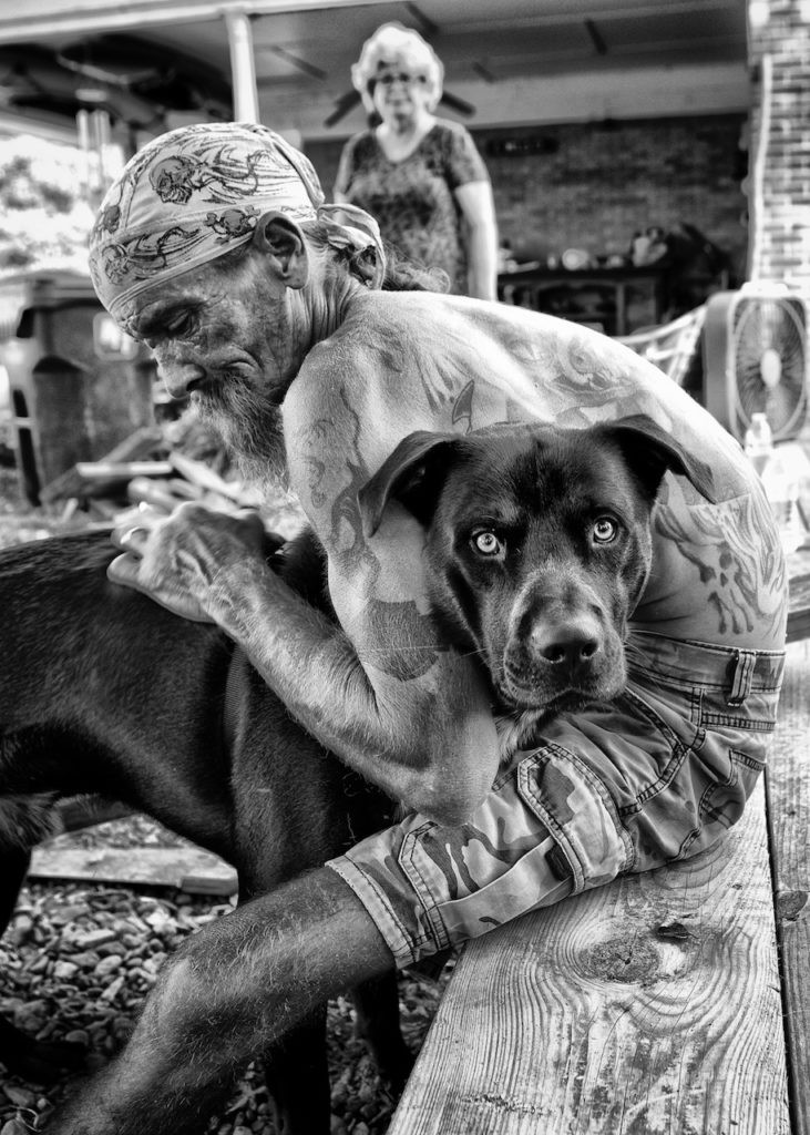 Delta man with his dog