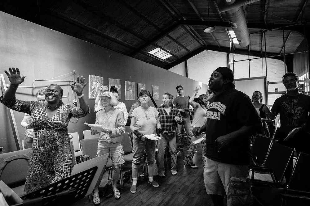 Choir members rehearsing