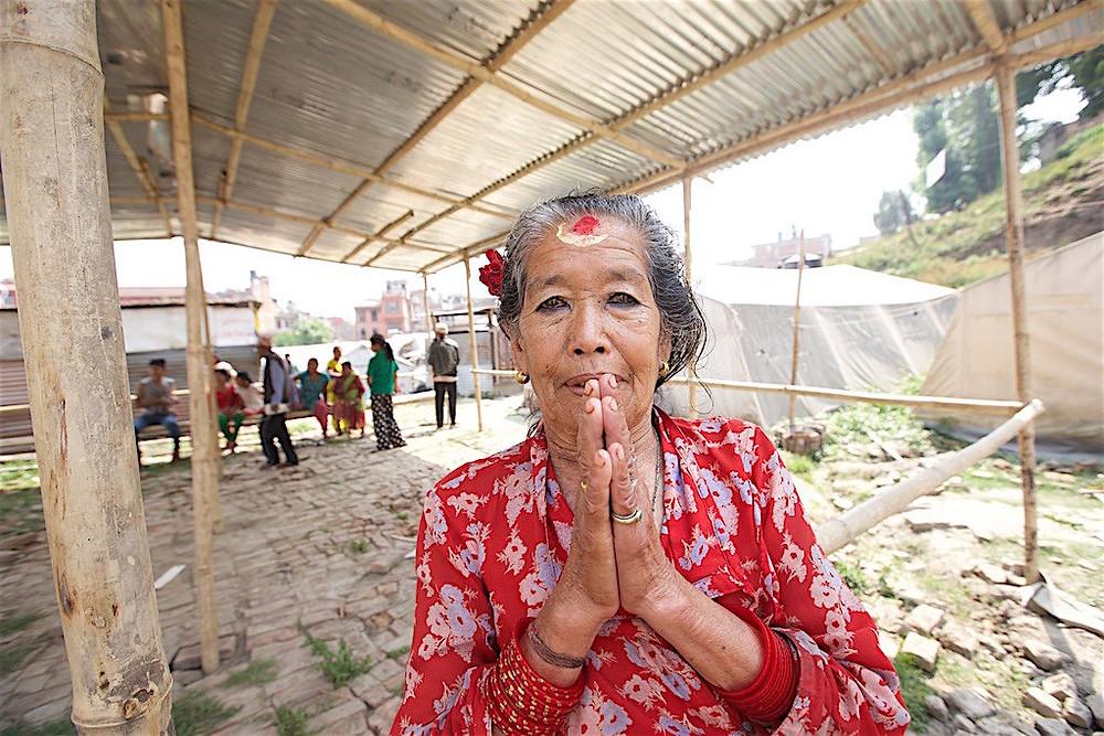 Woman gives namaste mudra gesture