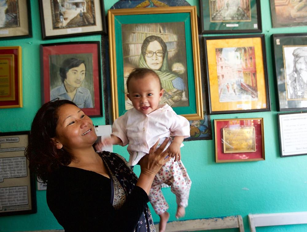 Indira Ramanagar holds up baby PA Nepal