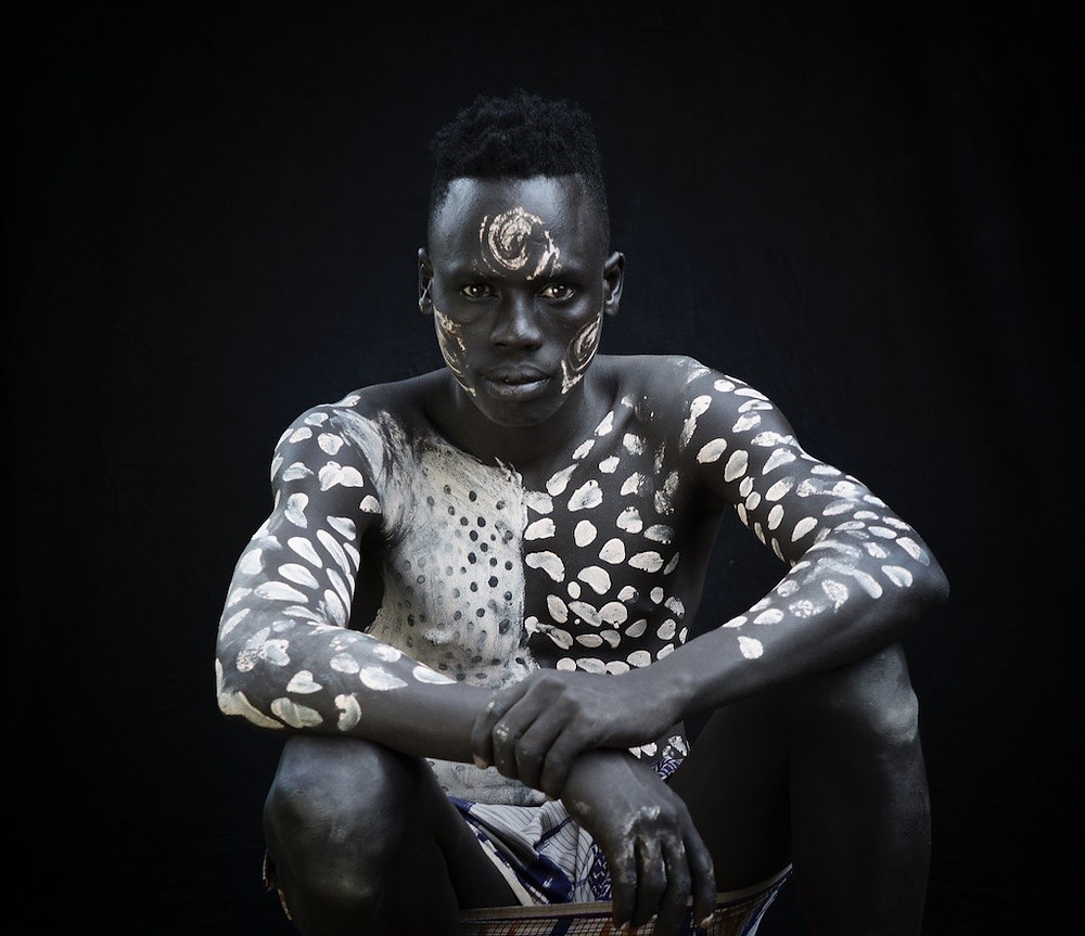 Omo River Valley youth in body art