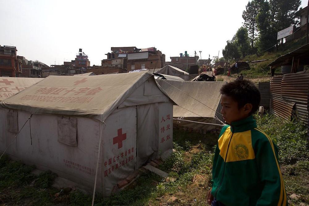 Boy overlooks medic tent