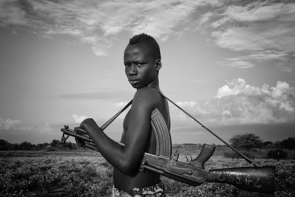 Omo River Valley with rifle on strap