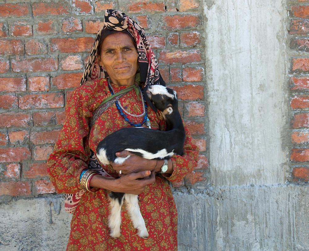 Woman holding goat