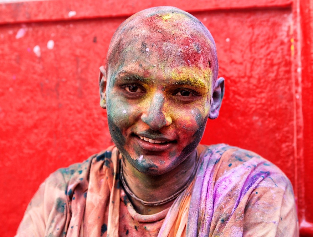 young man covered in dye