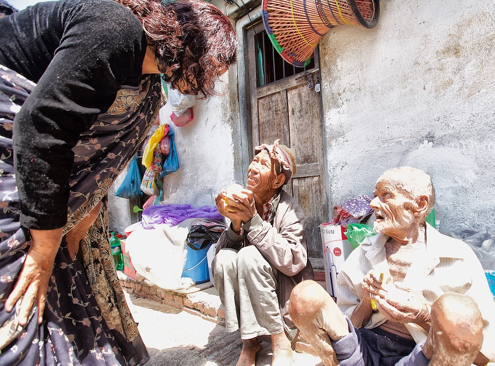 Indira Ramanagar talks to child on street PA Nepal